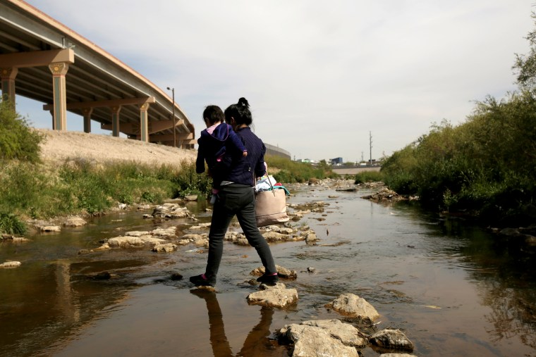 Image: A Central American migrant and her baby cross the Rio Bravo to request asylum in the United States near El Paso on April 1, 2019.