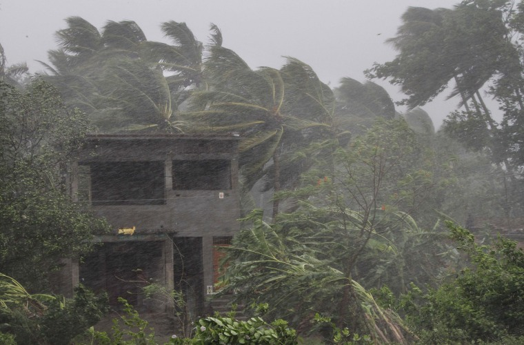 Image: An abandoned house and trees bend with gusty winds ahead off the landfall of cyclone Fani on the outskirts of Puri, in the Indian state of Odisha