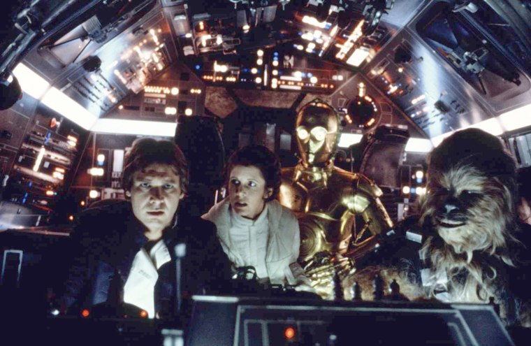 Image: American actors Harrison Ford, Carrie Fisher, British actors Anthony Daniels and Peter Mayhew on the set of Star Wars: Episode V - The Empire Strikes Back