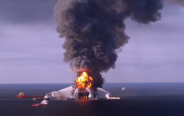 Image: Fire boat response crews as they battle the blazing remnants of the off shore oil rig Deepwater Horizon