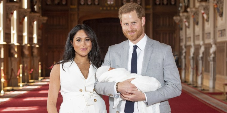 534818262 The Duke and Duchess of Sussex with their baby son during a photo-call in  St. George s Hall at Windsor Castle.AP