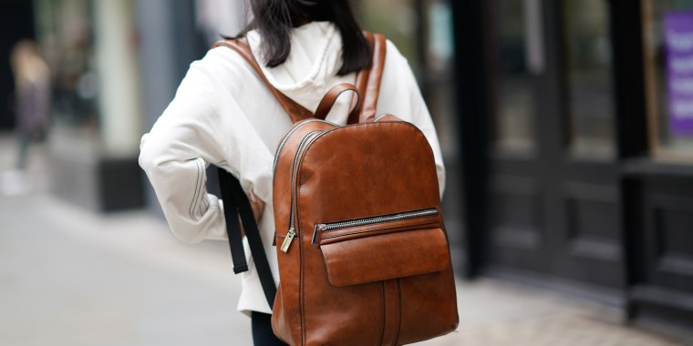 More women are wearing backpacks to the office