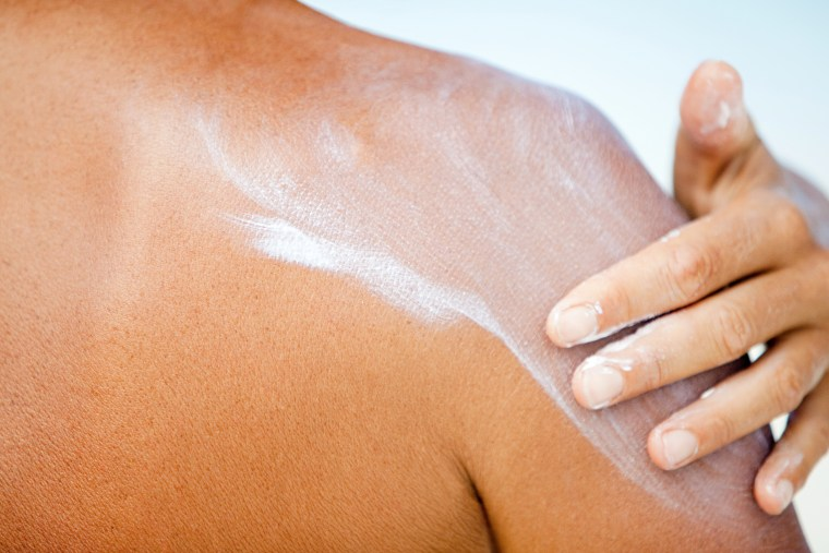 Image: Woman applying sunscreen, Maldives