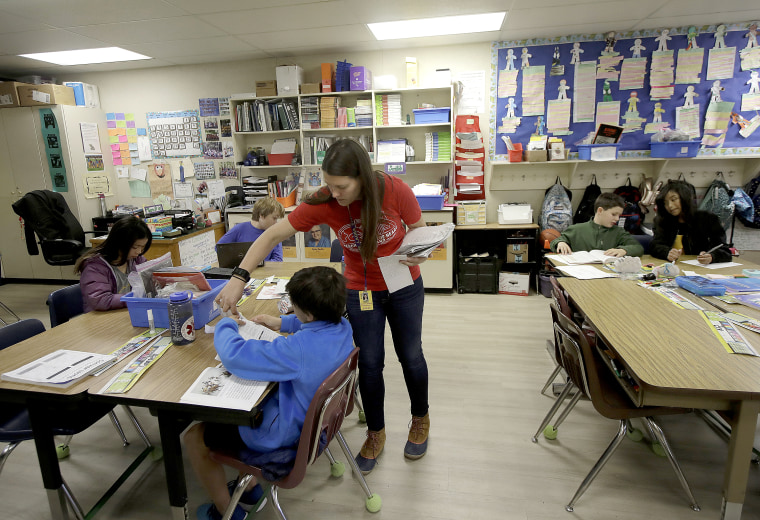 Laura Shield, a fourth grade teacher at Chabot Elementary School in Oakland, California, with a student in March.