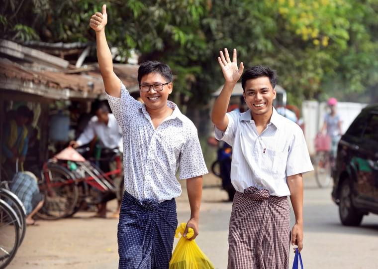Image: Reuters reporters Wa Lone and Kyaw Soe Oo gesture as they walk free outside Insein prison after receiving a presidential pardon in Yangon, Myanmar