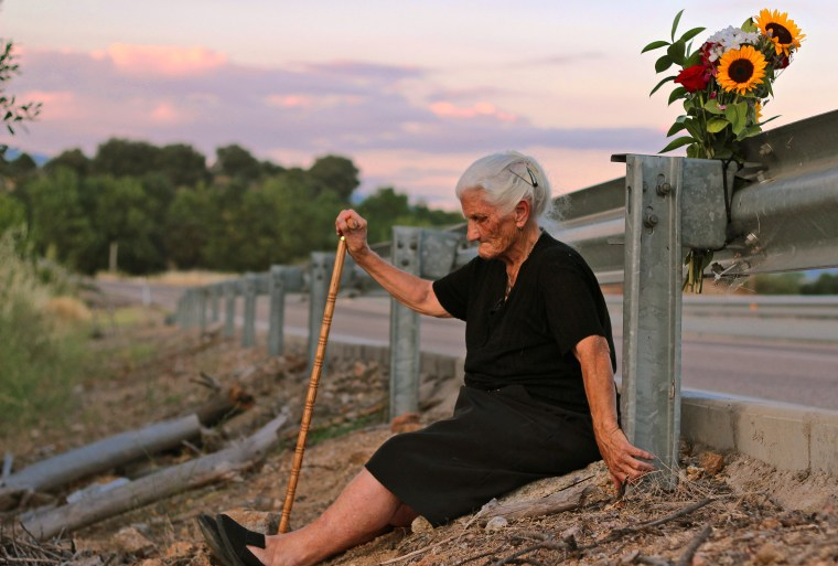 María Martin by the road that covers the mass grave containing her mother's remains.
