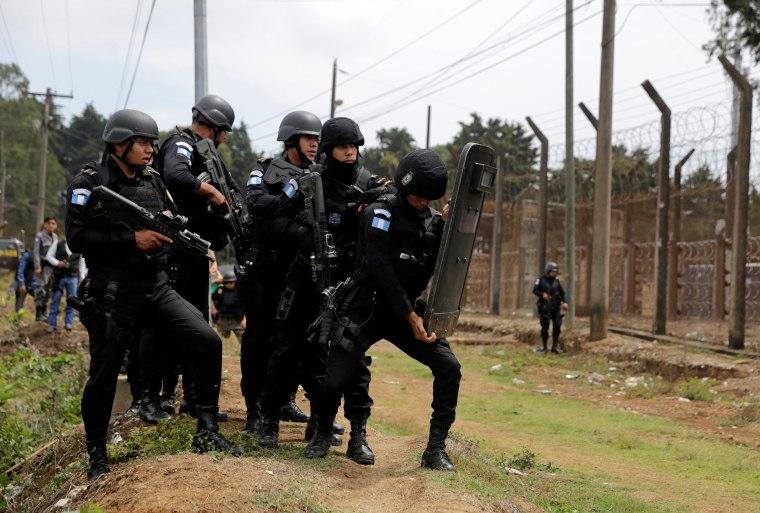 Image: Police officers guard outside Pavon prison, near Guatemala City