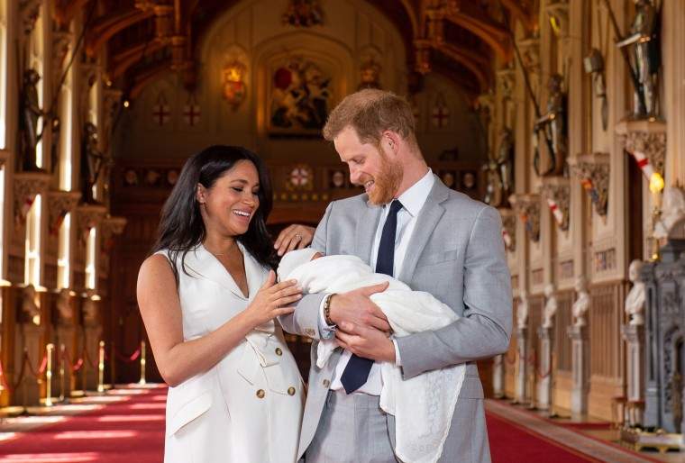 Image: The Duke and Duchess of Sussex with their baby son, who was born on Monday morning, during a photocall in St George's Hall at Windsor Castle in Berkshire