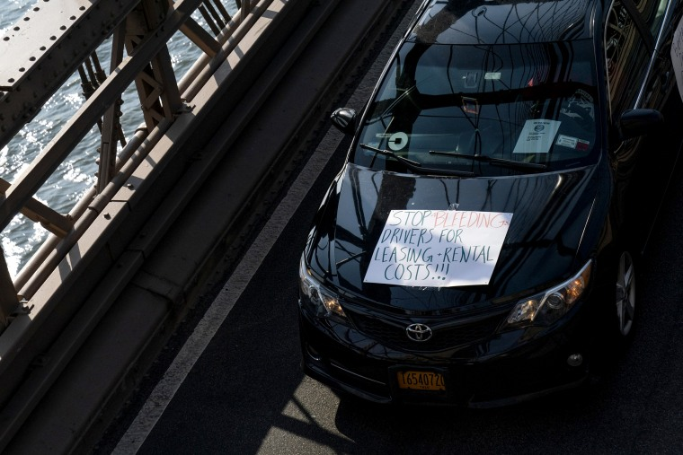 Image: Members of the Independent Drivers Guild drive across the Brooklyn Bridge in protest of Uber and Lyft on May 8, 2019.