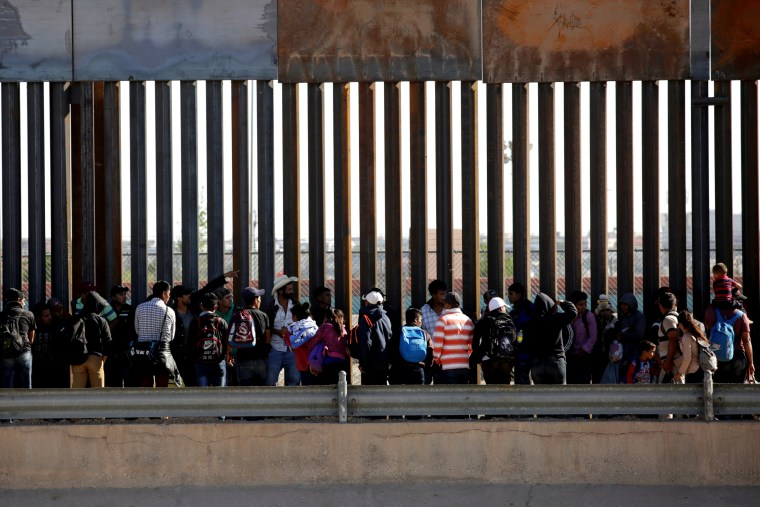 Image: Migrants wait to request asylum after crossing the U.S.-Mexico Border into El Paso, Texas, on April 21, 2019.