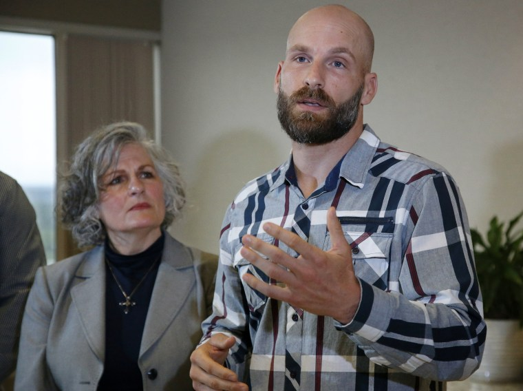 Image: Michael Behenna speaks at a news conference with his mother, Vicki, in Oklahoma City on May 8, 2019.