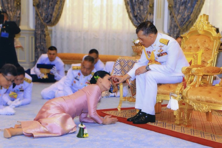 Image: Thailand's King Maha Vajiralongkorn touches the face of his new wife, Queen Suthida, during their wedding ceremony in Bangkok on May 1, 2019.