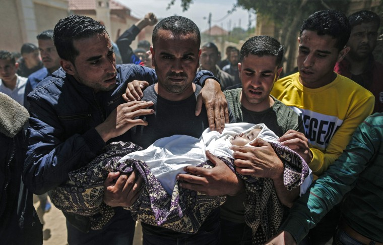 Image: Palestinian mourners carry the body of Saba Abu Arar during her funeral in Gaza City on May 5, 2019. According to the Palestinian Health Ministry, the baby and a pregnant relative were killed by an Israeli airstrike a day earlier, but Israel's army