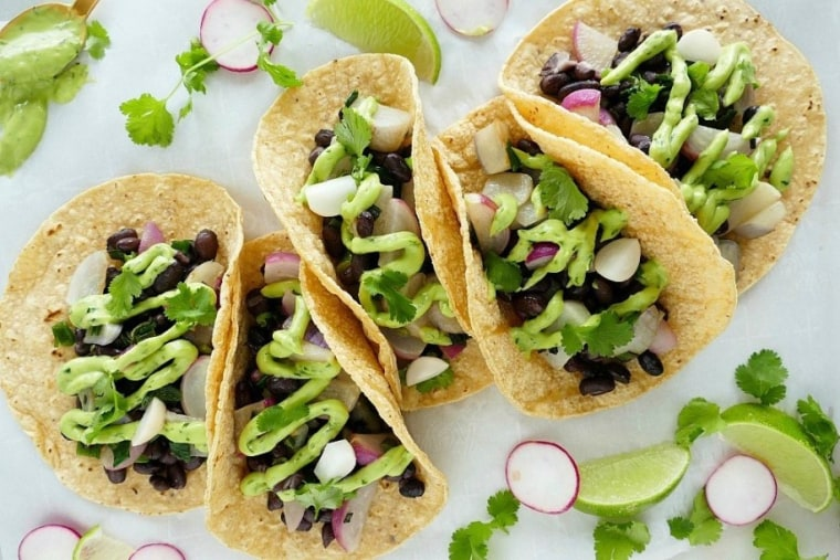 These radish and black bean tacos perfect example of how to look at your next taco Tuesday night through a Mediterranean lens.