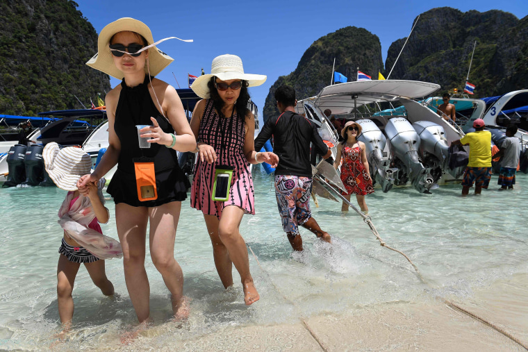 Image: Tourists get off a speedboat onto Maya Bay, on the southern Thai island of Koh Phi Phi