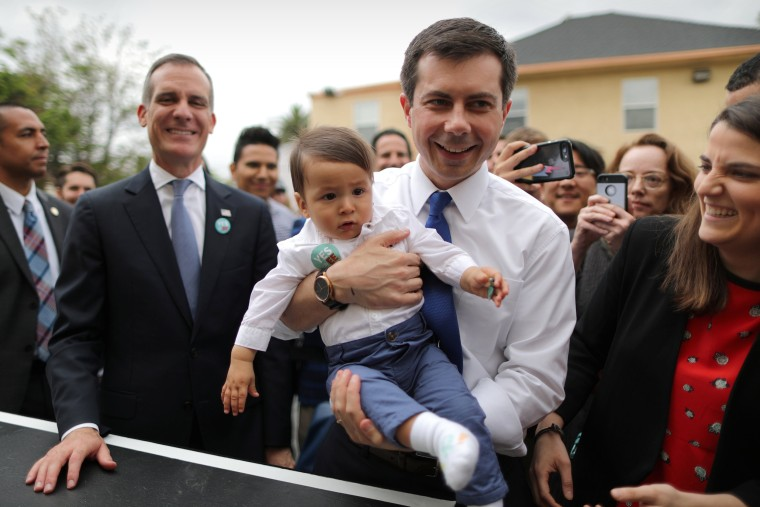 Image: U.S. Democratic presidential candidate Mayor Pete Buttigieg picks up a baby as he campaigns with Los Angeles Mayor Eric Garcetti in Los Angeles