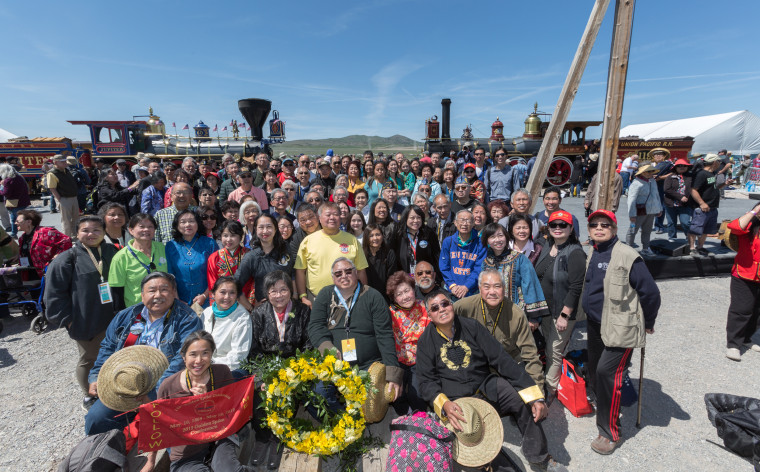 Railroad worker descendants, veterans, volunteers, and attendees pose during the 150 Year Transcontinental Railroad completion ceremony in Promontory, Utah.