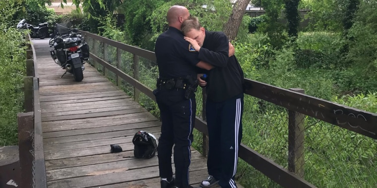 Officer embraces missing autistic man after he was found