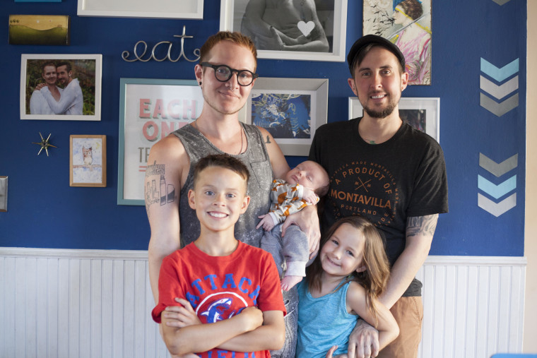 Biff Chaplow (left) and Trystan Reese (right) with their children (L-R) Riley, Leo and Hailey