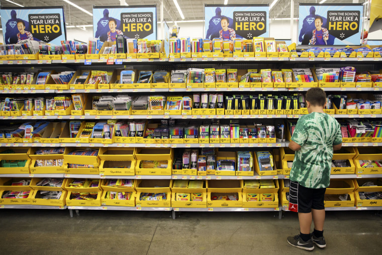 Image: A child browses school supplies