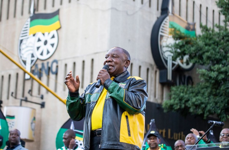 Image: President Elect of South Africa and President of the African National Congress Cyril Ramaphosa gestures as he delivers a speech outside Lithuli House, the ANC's headquarters in Johannesburg