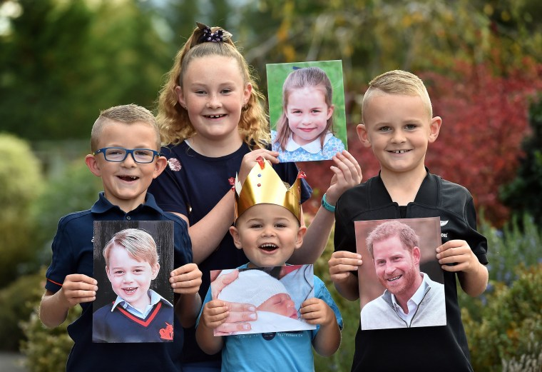 Image: Putting on their best royal poses are (from left) George, Charlotte, Archie and Harry Stafford, holding photos of their namesakes.