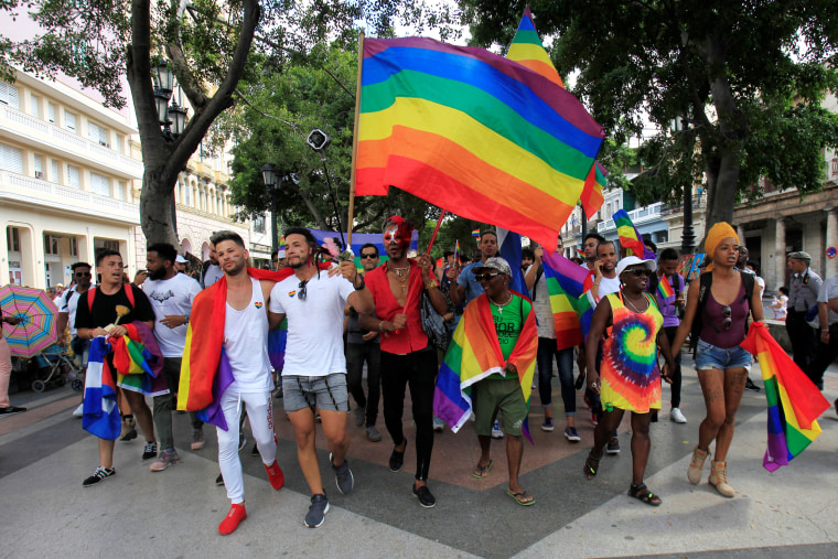 Image: LGBT activists hold flags during a demonstration in Havana on May 11, 2019.