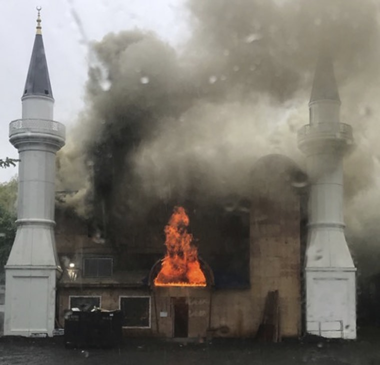 In this photo provided by Lina Biroscak, a fire burns at a mosque Sunday in New Haven, Conn.