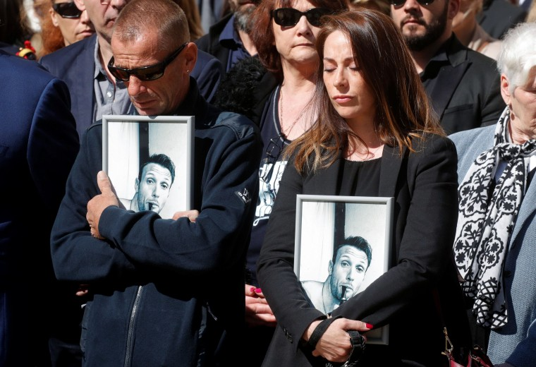 Image: Family members of slain French commandos Cedric de Pierrepont and Alain Bertoncello