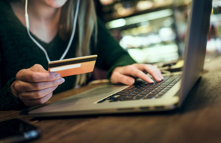 Image: Photo of a young woman shopping online