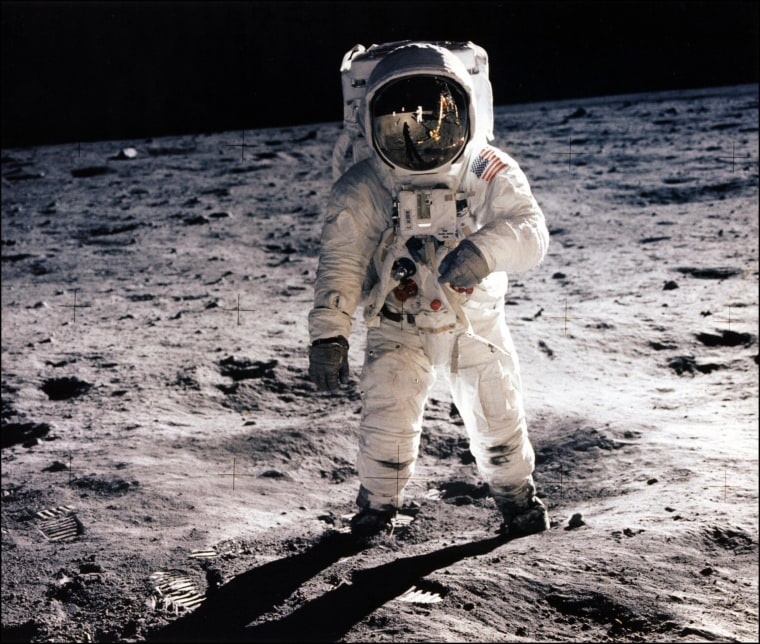 Image: astronaut Edwin E. Aldrin Jr. walks on the surface of the moon .
