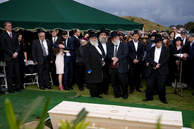 Image: Hannah Kaye, along with Jewish community leaders and mourners, stand near the coffin of her mother, Lori Kaye, at El Camino Cemetery in San Diego, California, on April 29, 2019. Lori Kaye was fatally shot at a synagogue in Poway.