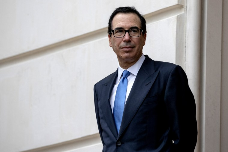 Image: Treasury Secretary Steve Mnuchin waits outside the Office of the U.S. Trade Representative in Washington on May 10, 2019.