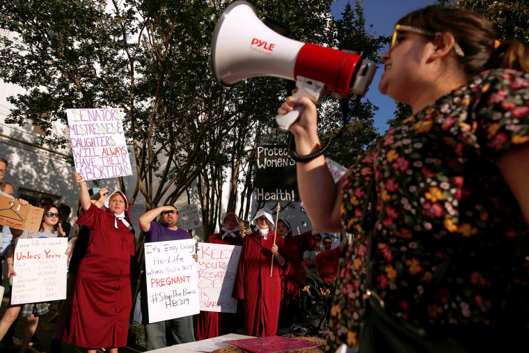Image: Pro-choice supporters protest in front of the Alabama State House as Alabama state Senate votes on the strictest anti-abortion bill in the United States at the Alabama Legislature in Montgomery