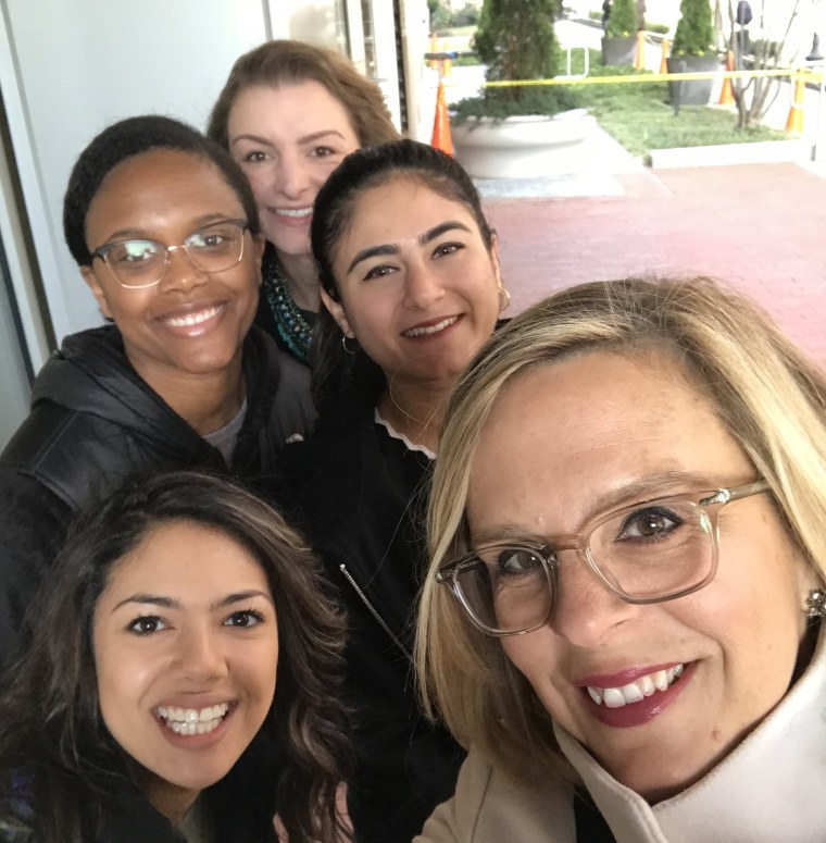 Kim Churches, CEO of the AAUW, with colleagues and interns. From bottom left, clockwise: Alyssa Thibodeau, Leah Daniels, Kathryn Bibler, Gabriella Kamran.