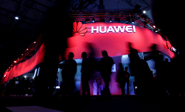 Image: Visitors walk past the Huawei booth at the Mobile World Congress in Barcelona on Feb. 27, 2017.