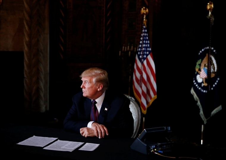 President Donald Trump takes questions from the media after speaking via teleconference with troops from Mar-a-Lago estate in Palm Beach