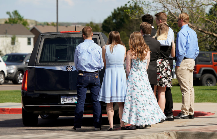 Image: Pallbearers watch the hearse leave after loading the coffin of shooting victim Kendrick Castillo of the Science, Technology, Engineering and Math (STEM) School after his memorial service in Highlands Ranch