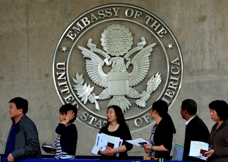Image: Chinese citizens wait to submit visa applications at the United States Embassy in Beijing on May 2, 2012.