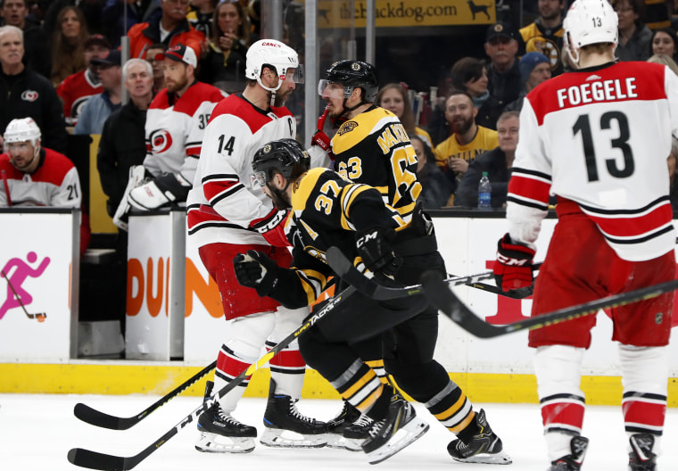 BO Carolina Hurricanes right wing Justin Williams and Boston Bruins left wing Brad Marchand face off