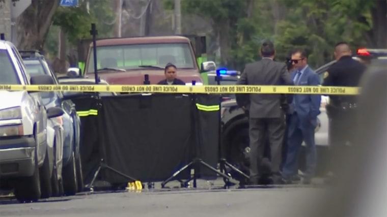 Image: Police investigate murder scene
