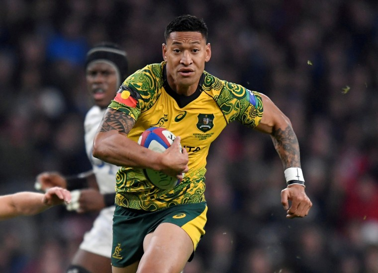 Image: Australia's Israel Folau runs in to score their first try during the England v Australia rugby union match at Twickenham Stadium, London