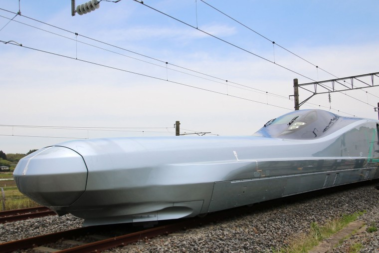 Image: A prototype of Japan's next-generation Shinkansen bullet train, set to be the fastest train on wheels when it enters service, reached speeds of 320 kilometres (198 miles) per hour on a test run on May 16