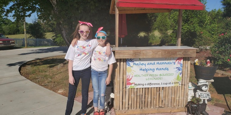Hannah and Hailey Hager started a lemonade stand so local families who owed lunch money to district schools wouldn't have to pay back their debt.