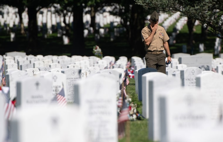 A member of the US military visits Section 60 at Arlington National Cemetery in Arlington, Virginia, May 24, 2019, ahead of the Memorial Day weekend. - Section 60 is the final resting place for US soldiers killed in America's most recent wars, especially Iraq and Afghanistan.