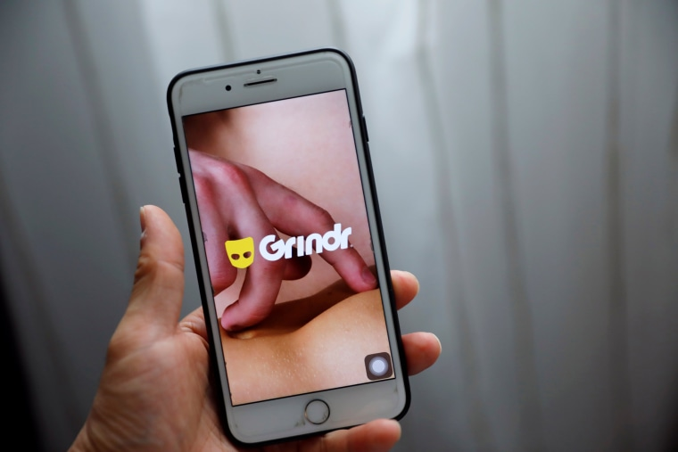 Image: Grindr app is seen on a mobile phone in this photo illustration taken in Shanghai