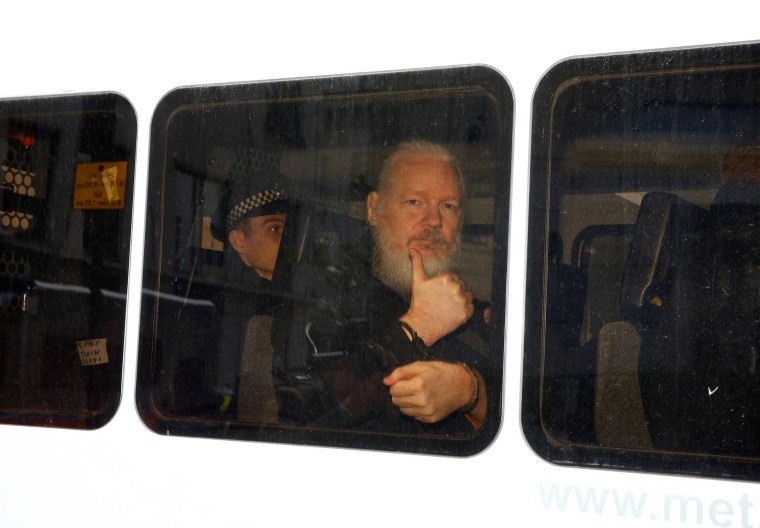 Image: WikiLeaks founder Julian Assange in a police van after was arrested by British police outside the Ecuadorian embassy in London