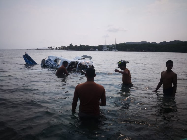Image: Honduran firefighters at the site of an accident where a light plane crashed into the sea at the Isla Bonita Area, in Roatan, Honduras