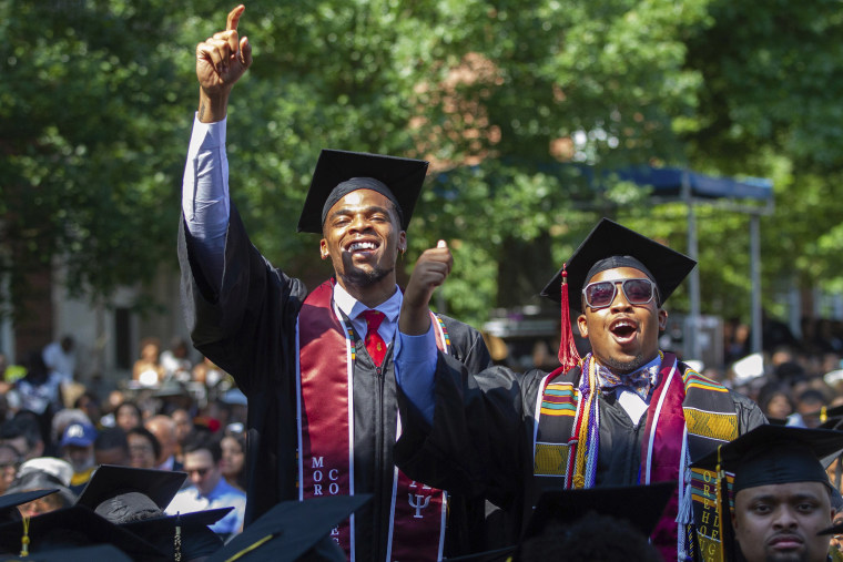 Image: Graduates react after hearing billionaire technology investor and philanthropist Robert F. Smith say he will provide grants to wipe out the student debt of the entire 2019 graduating class at Morehouse College in Atlanta