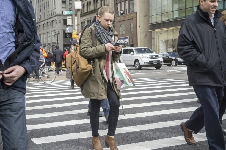 Image: Texting and walking in NY may get you a fine